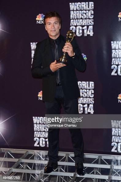 Tony Carreira poses with an Award during the ceremony of the World ...