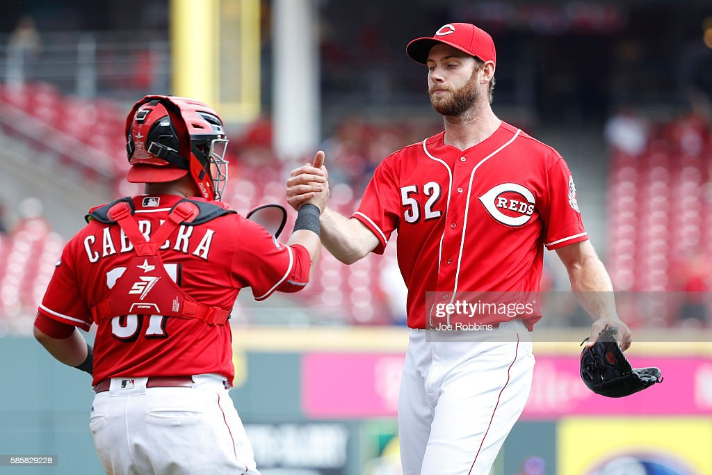 Tony Cingrani and Ramon Cabrera of the Cincinnati Reds celebrate after the final out in the ninth inning against the St Louis Cardinals at Great...