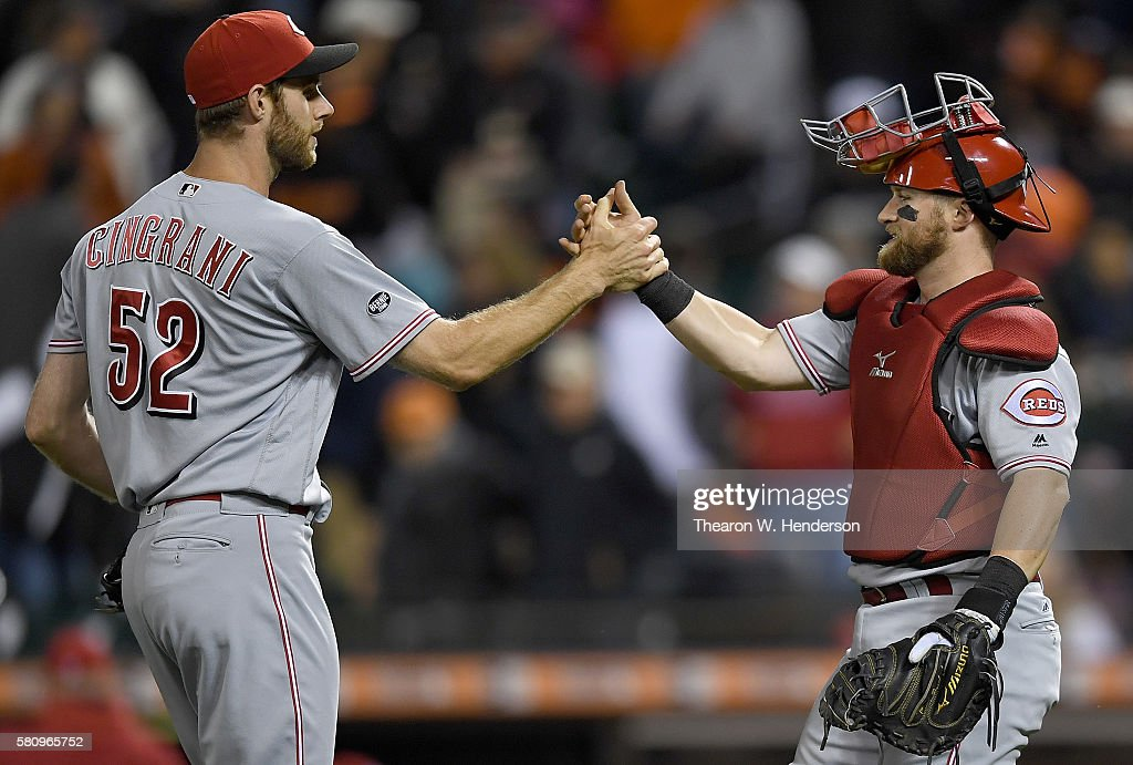 Tony Cingrani and Tucker Barnhart of the Cincinnati Reds celebrates defeating the San Francisco Giants 75 at ATT Park on July 25 2016 in San...