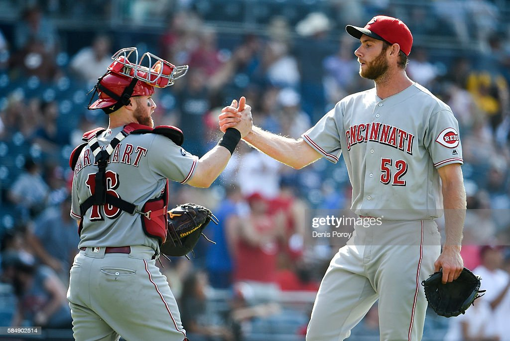 Tony Cingrani of the Cincinnati Reds is congratulated by Tucker Barnhart after beating the San Diego Padres 32 in a baseball at PETCO Park on July 31...