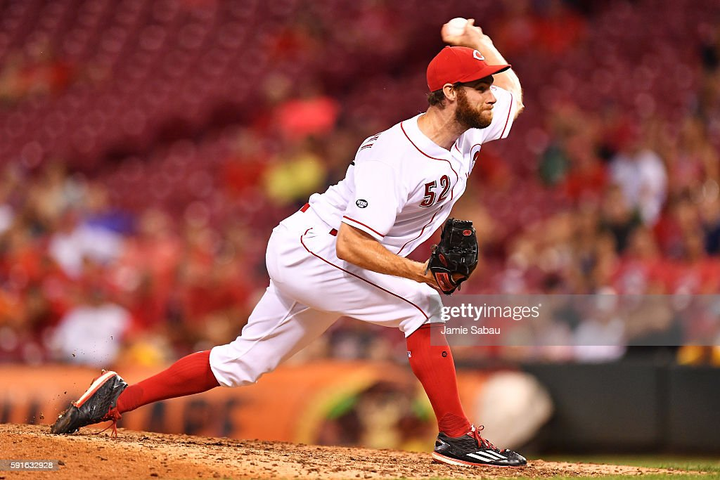 Tony Cingrani of the Cincinnati Reds pitches in the ninth inning against the Miami Marlins at Great American Ball Park on August 17 2016 in...