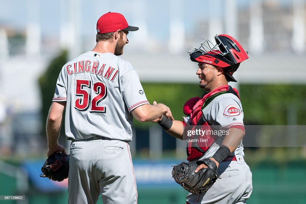 Tony Cingrani of the Cincinnati Reds shakes hands with Ramon Cabrera after the final out in the Cincinnati Reds 73 win over the Pittsburgh Pirates at...