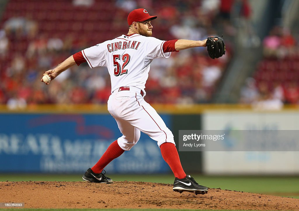 Tony Cingrani of the Cincinnati Reds throws a pitch during the game against the Chicago Cubs at Great American Ball Park on September 10 2013 in...