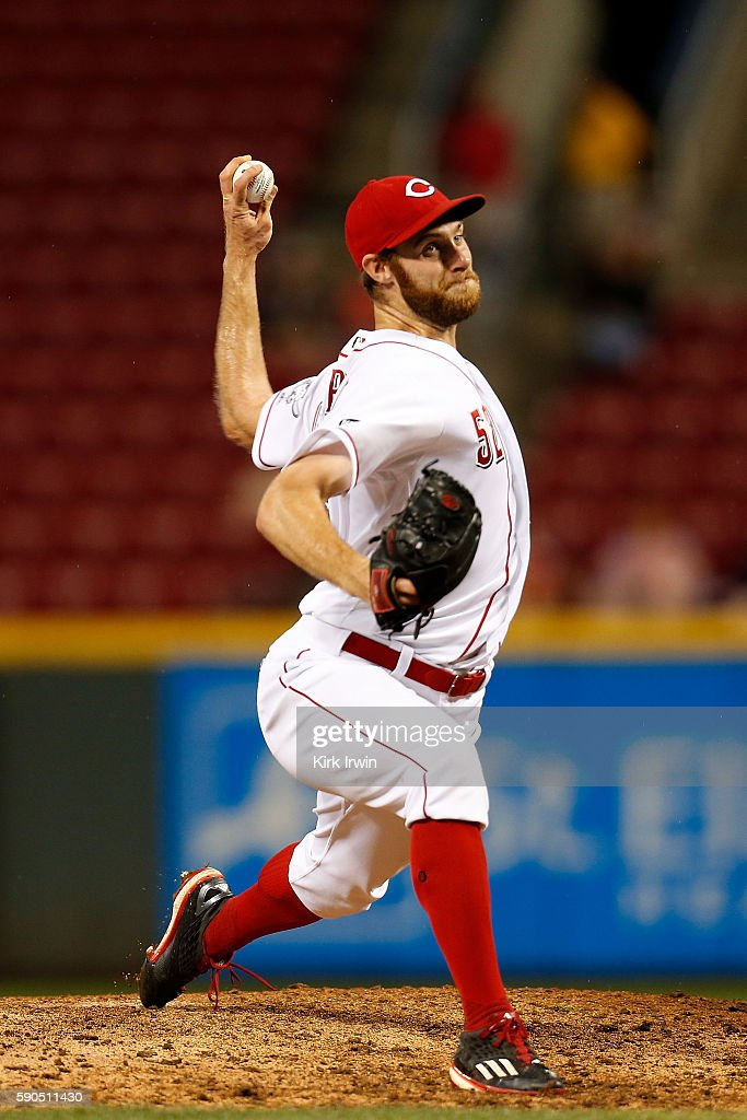 Tony Cingrani of the Cincinnati Reds throws a pitch while getting the save during the ninth inning of the game against the Miami Marlins at Great...