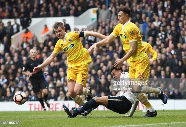 Tony Craig of Millwall and Jake Cooper of Millwall challenge Dele Alli of Tottenham Hotspur during The Emirates FA Cup QuarterFinal match between...