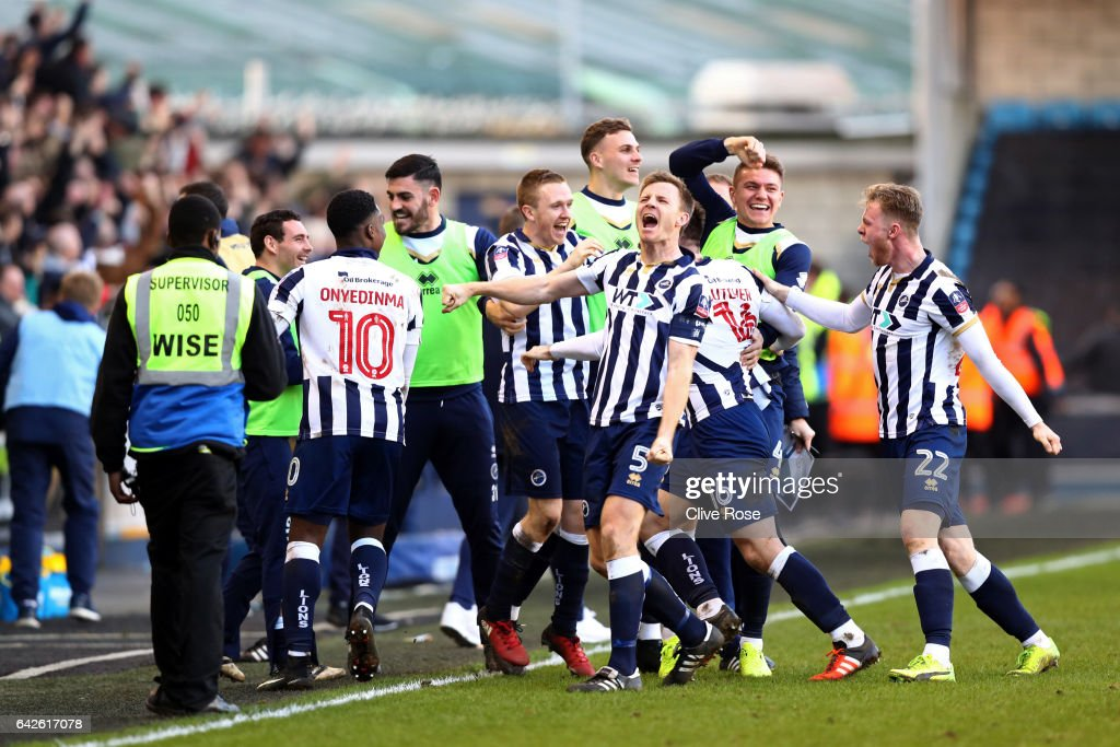 Tony Craig of Millwall (C) celebrates with his team mates after The Emirates FA Cup Fifth Round match between Millwall and Leicester City at The Den on February 18, 2017 in London, England.