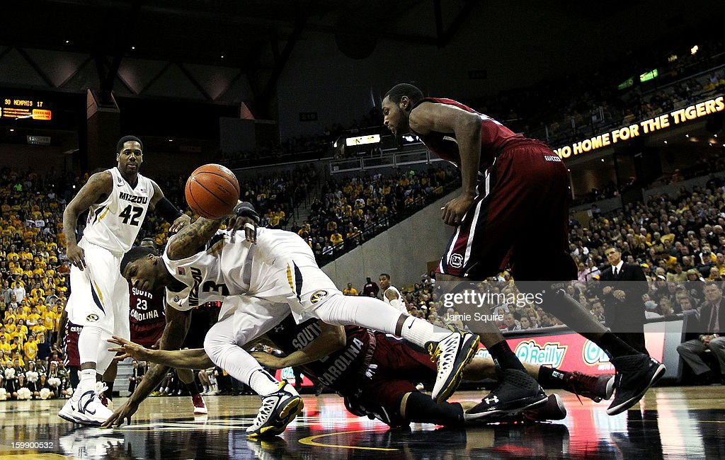 Tony Criswell #3 of the Missouri Tigers dives for a loose ball during the game against the South Carolina Gamecocks at Mizzou Arena on January 22, 2013 in Columbia, Missouri.