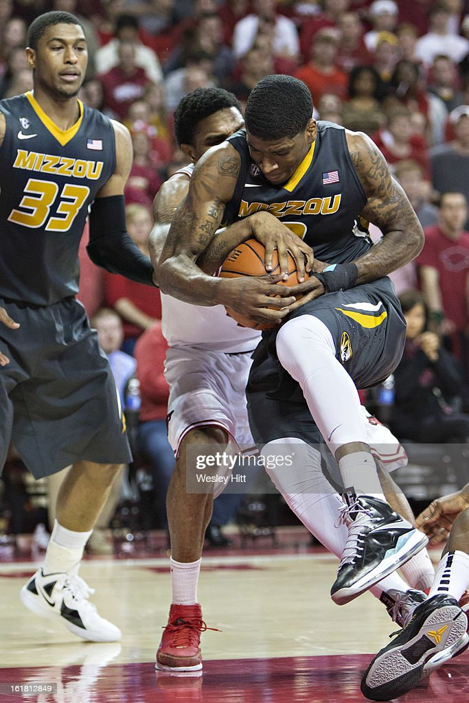 Tony Criswell #3 of the Missouri Tigers fights for a rebound with Coty Clarke #4 of the Arkansas Razorbacks at Bud Walton Arena on February 16, 2013 in Fayetteville, Arkansas. The Razorbacks defeated the Tigers 73-71.