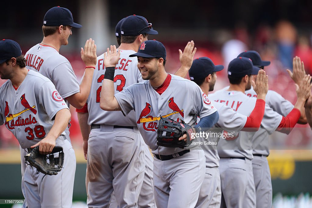 Tony Cruz #48 of the St. Louis Cardinals celebrates with his teammates after the Cardinals defeated the Cincinnati Reds 15-2 at Great American Ball Park on August 4, 2013 in Cincinnati, Ohio.