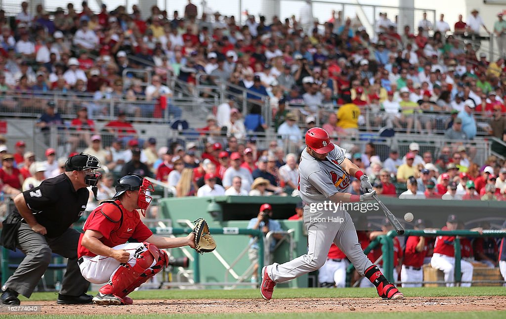 Tony Cruz #48 of the St. Louis Cardinals doubles to center scoring Adron Chambers #56, <a gi-track='captionPersonalityLinkClicked' href=/galleries/search?phrase=Daniel+Descalso&family=editorial&specificpeople=6800752 ng-click='$event.stopPropagation()'>Daniel Descalso</a> #33 and Matt Carpenter #13 during the third inning of the game against the Boston Red Sox at JetBlue Park on February 26, 2013 in Fort Myers, Florida.