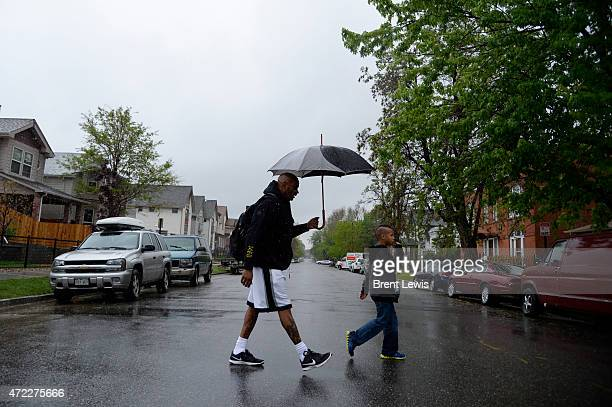 Tony Cunningham walks with his grandson Brancis home from school Tuesday May 5 2015 along 25th Avenue in the Whitter neighborhood in Denver Colorado...
