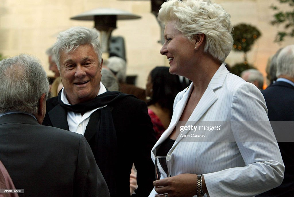 Tony Curtis and his wife Jill Curtis socialize in the courtyard of the mansion after the ceremonyAnne and Kirk Douglas celebrated their 50th wedding...