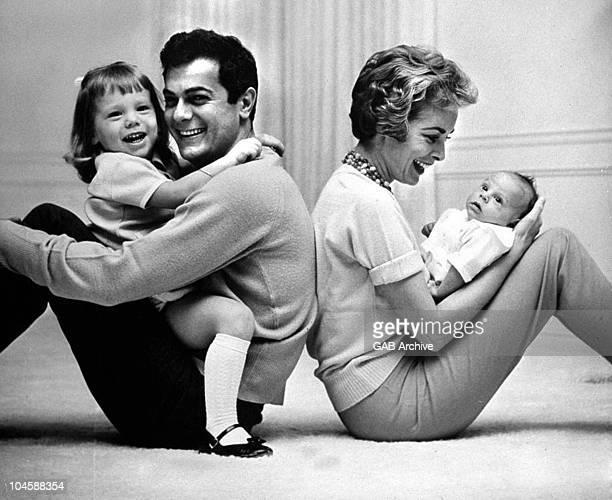Tony Curtis and Janet Leigh pose with their children Kelly Curtis and Jamie Lee Curtis in 1959 in the United States