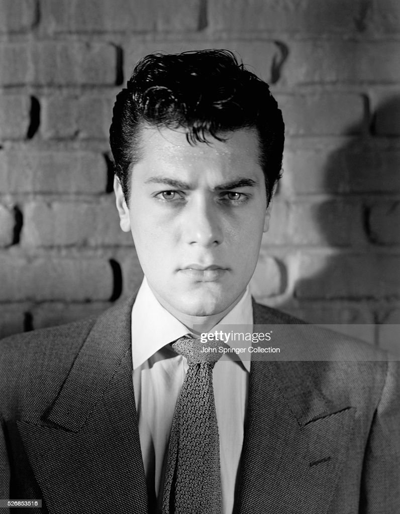 Tony Curtis in Front of Brick Wall