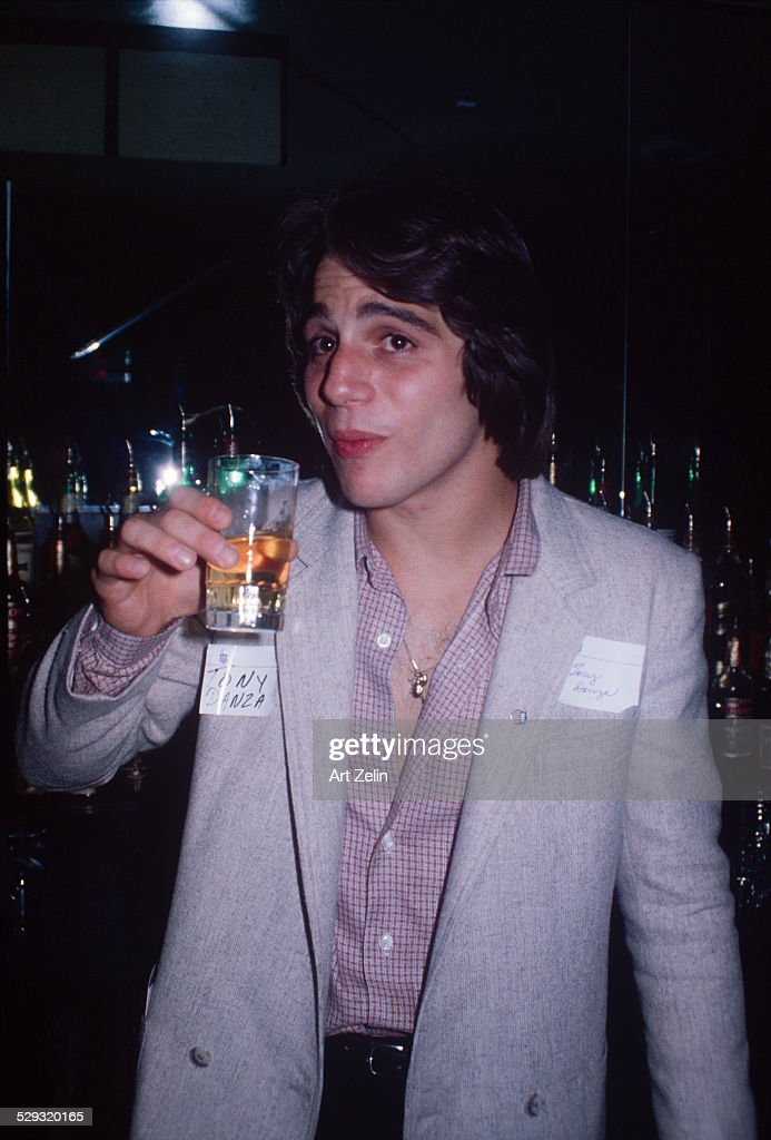 Tony Danza about to take a drink at a bar circa 1970 New York