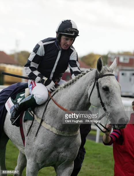 Tony Dobbin celebrates on board Monet's Garden after winning The BonusprintCom Old Roan Steeple Chase at Aintree Racecourse