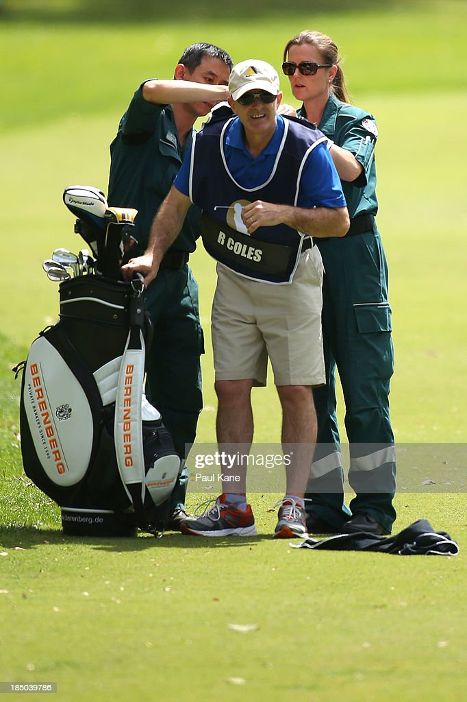Tony Dobson, caddie for Roberts Coles of England receives medical attention from paramedics for a bee sting during day one of the Perth International at Lake Karrinyup Country Club on October 17, 2013 in Perth, Australia.