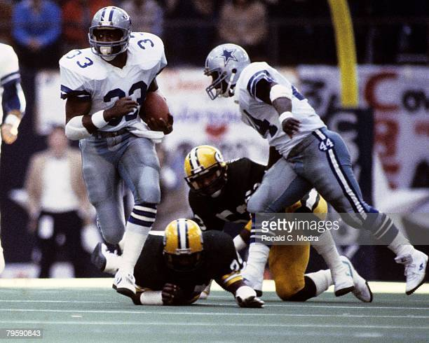 Tony Dorsett of the Dallas Cowboys carries the ball during the NFC Divisional Playoff Game against the Green Bay Packers on January 16 1983 in Dallas...