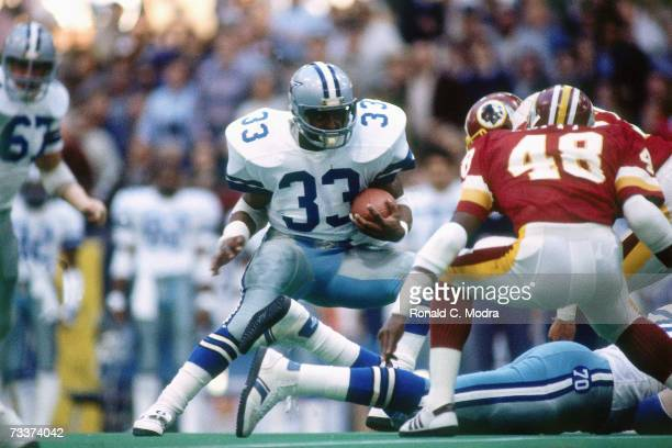 Tony Dorsett of the Dallas Cowboys carries the ball in a game against the Washington Redskins on December 11 l983 in Irving Texas