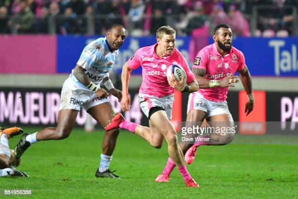 Tony Ensor of Stade Francais Paris makes a break to set up Waisea Nayacalevu of Stade Francais Paris for a try during the Top 14 match between Stade...