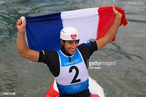 Tony Estanguet of France celebrates with the French Flag after competing in the Men's Canoe Single Slalom final on Day 4 of the London 2012 Olympic...