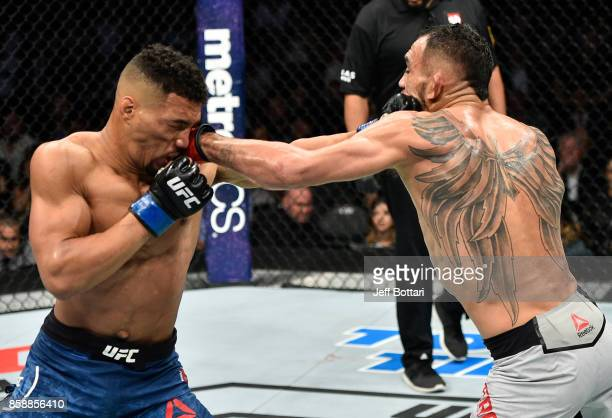Tony Ferguson and Kevin Lee trade punches in their interim UFC lightweight championship bout during the UFC 216 event inside TMobile Arena on October...