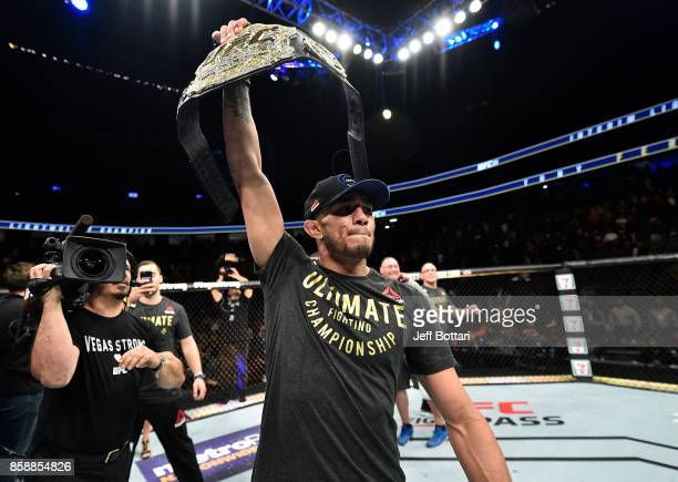 Tony Ferguson celebrates after his submission victory over Kevin Lee in their interim UFC lightweight championship bout during the UFC 216 event...