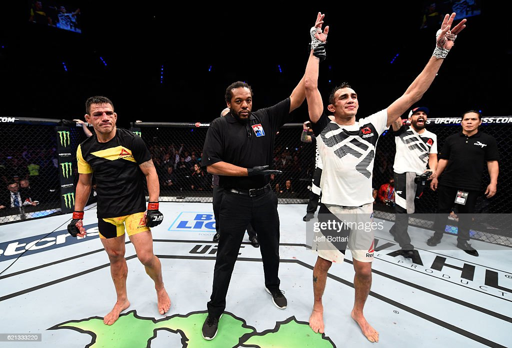 Tony Ferguson of the United States celebrates his victory over Rafael Dos Anjos of Brazil in their lightweight bout during the UFC Fight Night event at Arena Ciudad de Mexico on November 5, 2016 in Mexico City, Mexico.