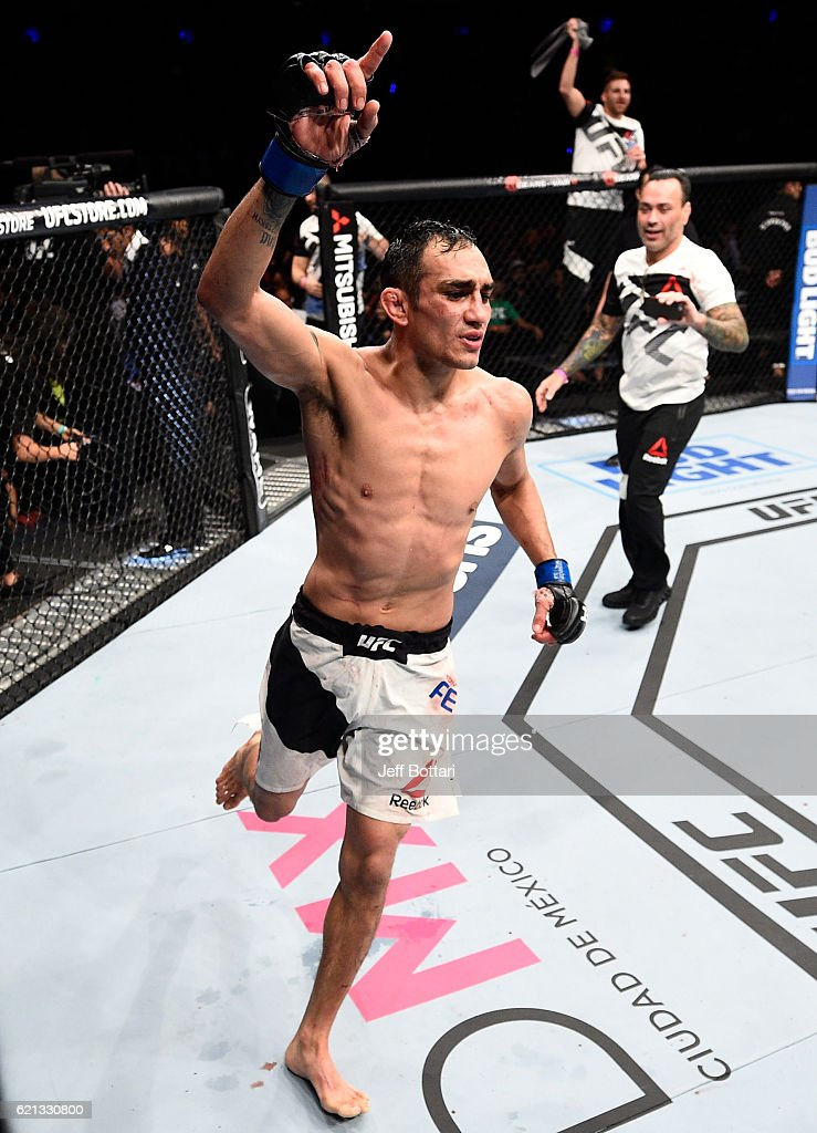 Tony Ferguson of the United States raises his hand after facing Rafael Dos Anjos of Brazil in their lightweight bout during the UFC Fight Night event at Arena Ciudad de Mexico on November 5, 2016 in Mexico City, Mexico.