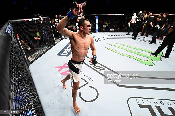 Tony Ferguson of the United States raises his hand after facing Rafael Dos Anjos of Brazil in their lightweight bout during the UFC Fight Night event...