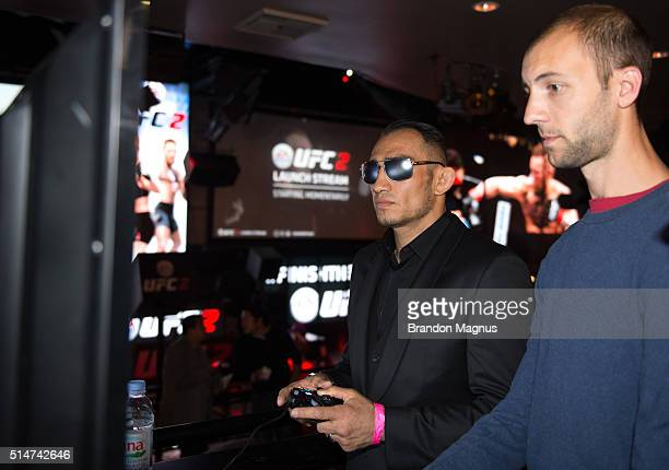 Tony Ferguson plays the UFC 2 game with a fan during the EA Sports UFC 2 Launch Party at LIGHT Nightclub in the Mandalay Bay resort and casino on...