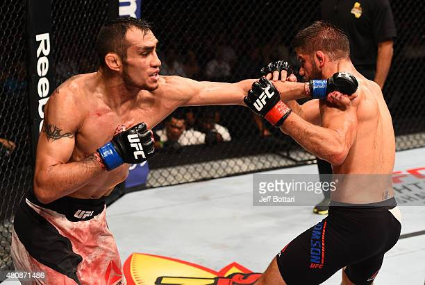 Tony Ferguson punches Josh Thomson in their lightweight bout during the UFC event at the Valley View Casino Center on July 15 2015 in San Diego...