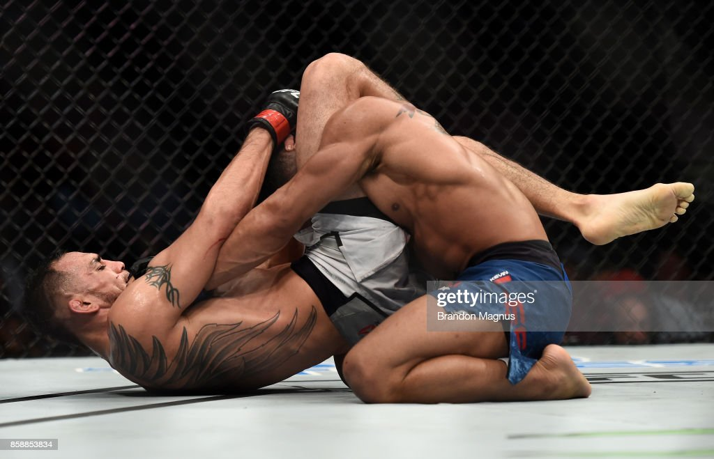 Tony Ferguson secures a triangle choke submission to defeat Kevin Lee in their interim UFC lightweight championship bout during the UFC 216 event inside T-Mobile Arena on October 7, 2017 in Las Vegas, Nevada.