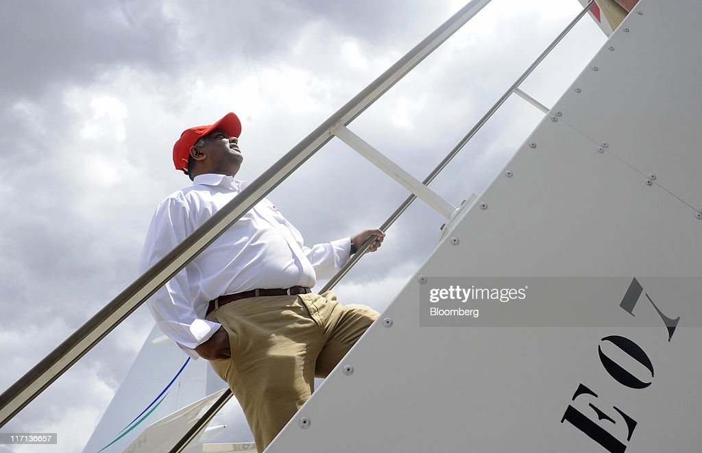 Tony Fernandes, chief executive officer of AirAsia Bhd., climbs aboard an aircraft at the Paris Air Show in Paris, on Thursday, June 23, 2011. The 49th International Paris Air Show, the world's largest aviation and space industry show, takes place at Le Bourget airport June 20-26. Photographer: Fabrice Dimier/Bloomberg via Getty Images