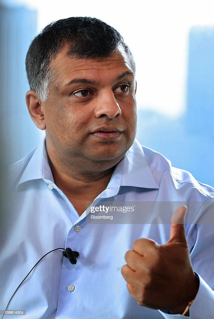 Tony Fernandes, chief executive officer of AirAsia Bhd., gestures as he speaks during an interview in Kuala Lumpur, Malaysia, on Thursday, Nov. 22, 2012. AirAsia, the region's biggest discount carrier, said it may add only one more major hub for expansion as it focuses on boosting profits from Malaysia, Thailand and Indonesia in the next three years. Photographer: Goh Seng Chong/Bloomberg via Getty Images