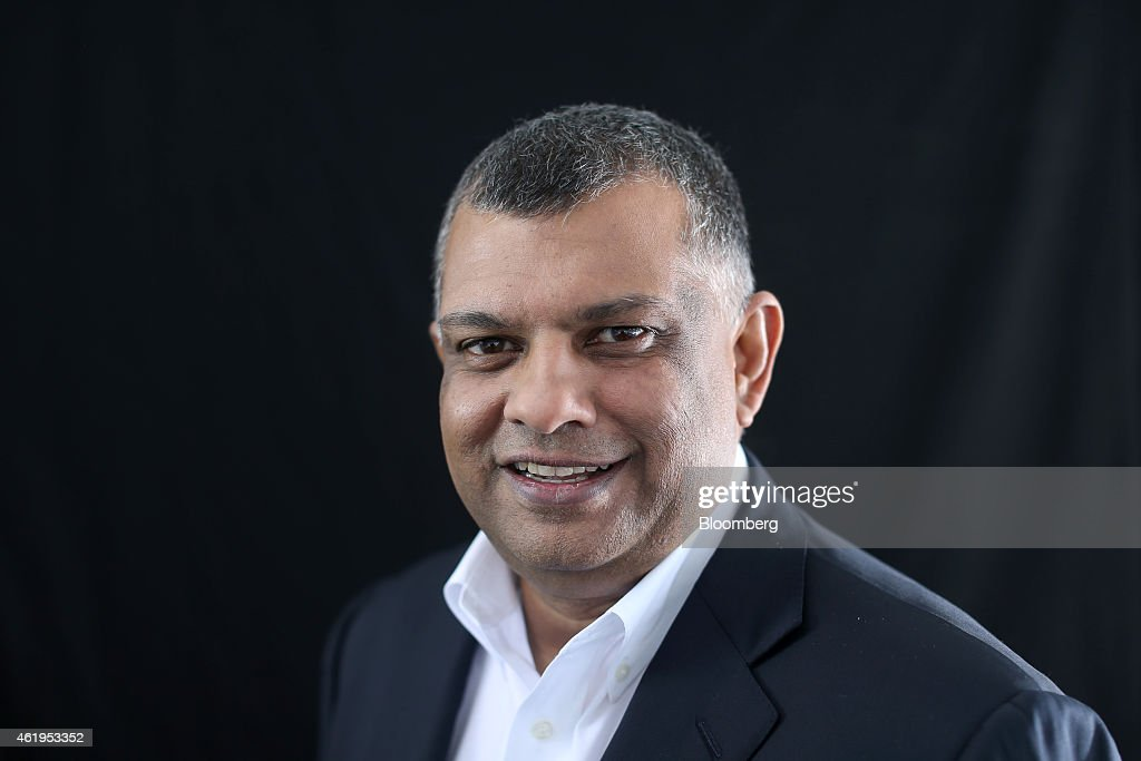 Tony Fernandes, chief executive officer of AirAsia Bhd., poses for a photograph following a Bloomberg Television interview on day two of the World Economic Forum (WEF) in Davos, Switzerland, on Thursday, Jan. 22, 2015. World leaders, influential executives, bankers and policy makers attend the 45th annual meeting of the World Economic Forum in Davos from Jan. 21-24. Photographer: Simon Dawson/Bloomberg via Getty Images