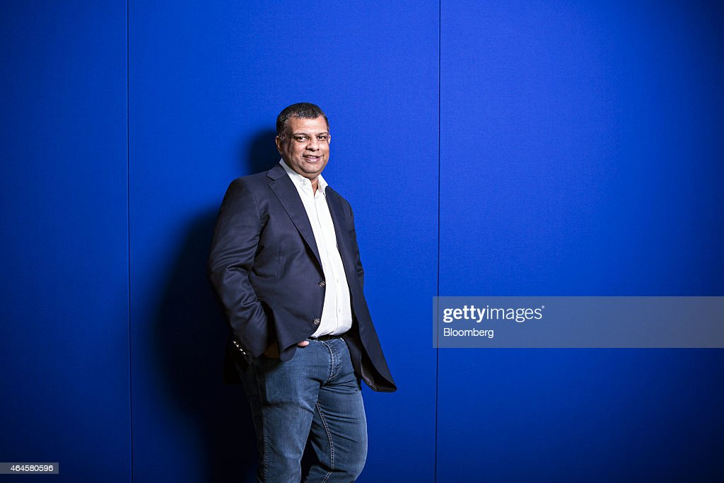Tony Fernandes, chief executive officer of AirAsia Bhd., poses for a photograph in Kuala Lumpur, Malaysia, on Friday, Feb. 27, 2015. AirAsia has good tailwinds behind it' with lower oil prices as well as strong performance from all its subsidiaries, Fernandes said on Bloomberg Television. Photographer: Charles Pertwee/Bloomberg via Getty Images