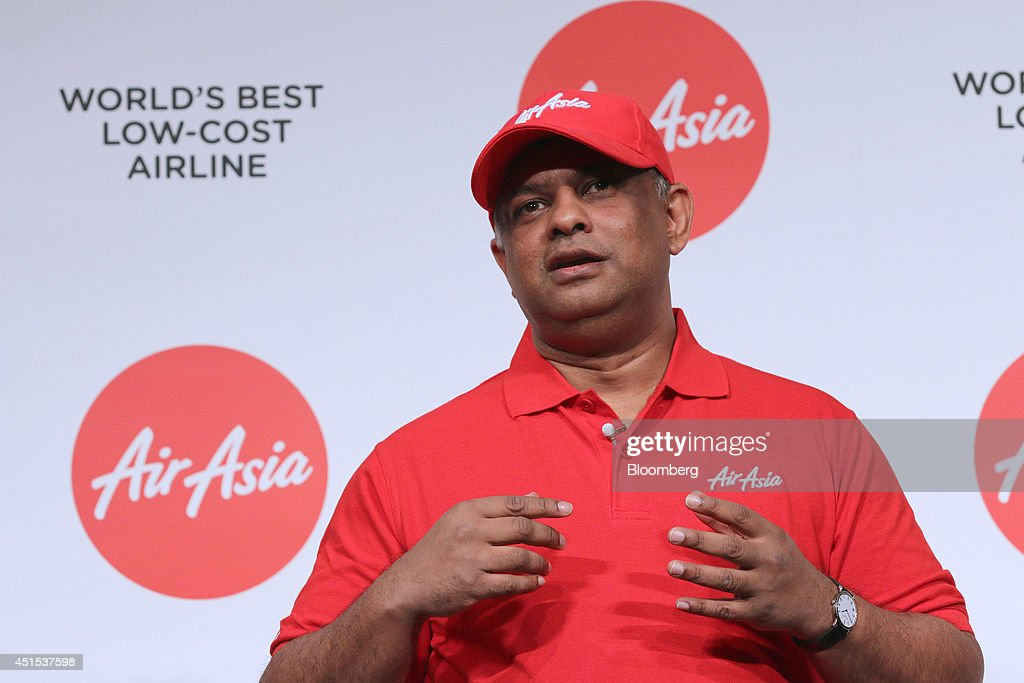 Tony Fernandes, chief executive officer of AirAsia Bhd., speaks during a news conference in Tokyo, Japan, on Tuesday, July 1, 2014. AirAsia, the region's biggest budget carrier, picked e-commerce company Rakuten for its second attempt at Japan's aviation market after pulling out of a tie-up with ANA Holdings Inc. last year. Photographer: Yuriko Nakao/Bloomberg via Getty Images