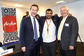 Tony Fernandes group chief executive officer of AirAsia Bhd center poses for a photograph with Fabrice Bregier chief executive officer of Airbus...