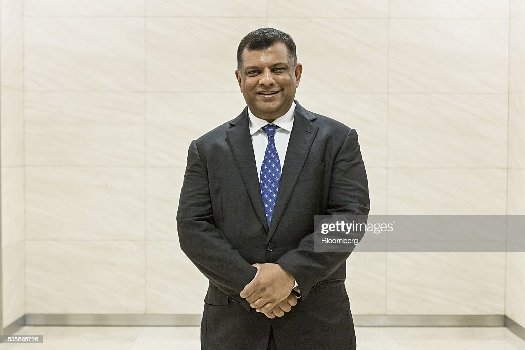 Tony Fernandes, group chief executive officer of AirAsia Bhd., stands for a photograph in Kuala Lumpur, Malaysia, on Monday, May 30, 2016. AirAsia, the region's biggest discount carrier, got an offer of about $1 billion to buy its aircraft-leasing company, amid a surge in the business in the continent. Photographer: Charles Pertwee/Bloomberg via Getty Images