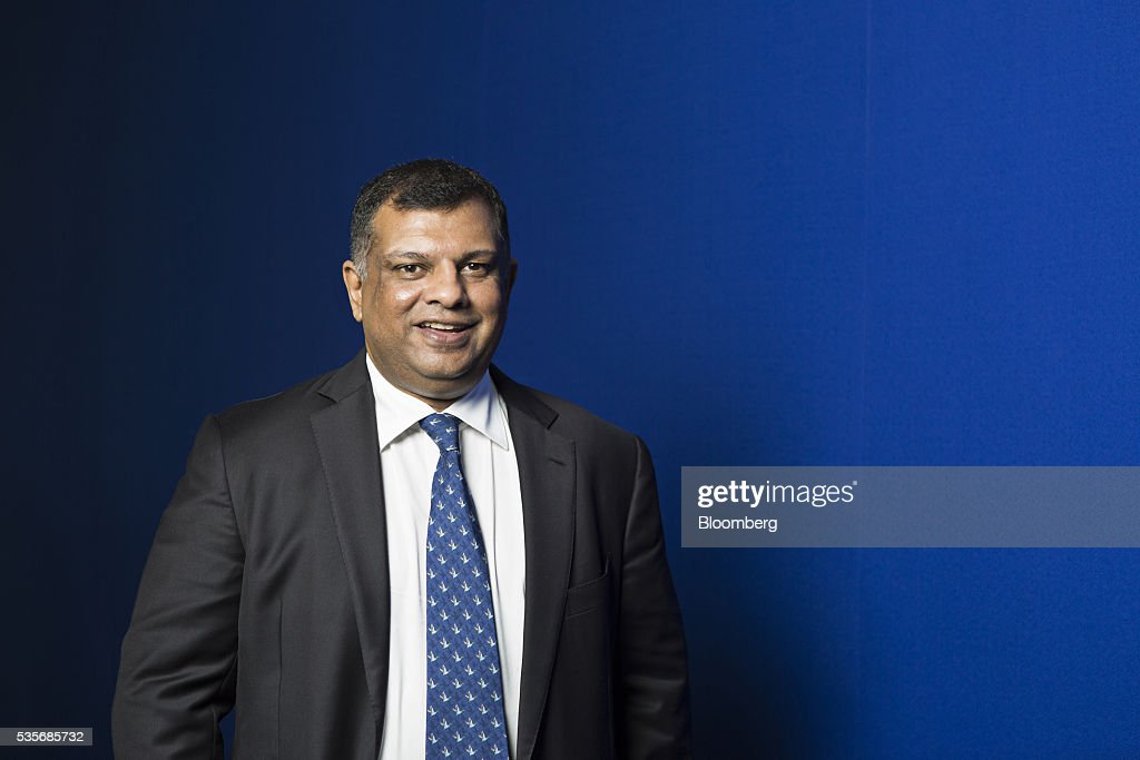 <a gi-track='captionPersonalityLinkClicked' href=/galleries/search?phrase=Tony+Fernandes&family=editorial&specificpeople=2103805 ng-click='$event.stopPropagation()'>Tony Fernandes</a>, group chief executive officer of AirAsia Bhd., stands for a photograph in Kuala Lumpur, Malaysia, on Monday, May 30, 2016. AirAsia, the region's biggest discount carrier, got an offer of about $1 billion to buy its aircraft-leasing company, amid a surge in the business in the continent. Photographer: Charles Pertwee/Bloomberg via Getty Images