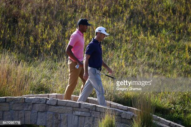 Tony Finau and Billy Horschel walk to the 18th green during the first round of the BMW Championship at Conway Farms Golf Club on September 14 2017 in...