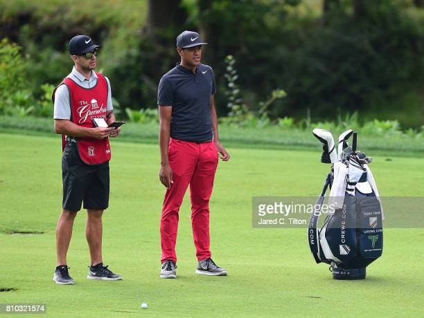 Tony Finau and his caddie converse on the 13th fairway during round two of The Greenbrier Classic held at the Old White TPC on July 7 2017 in White...