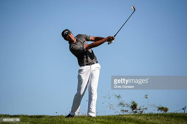 Tony Finau hits his second shot from the rough on the seventh hole during the second round of The Barclays at Plainfield Country Club on August 28...