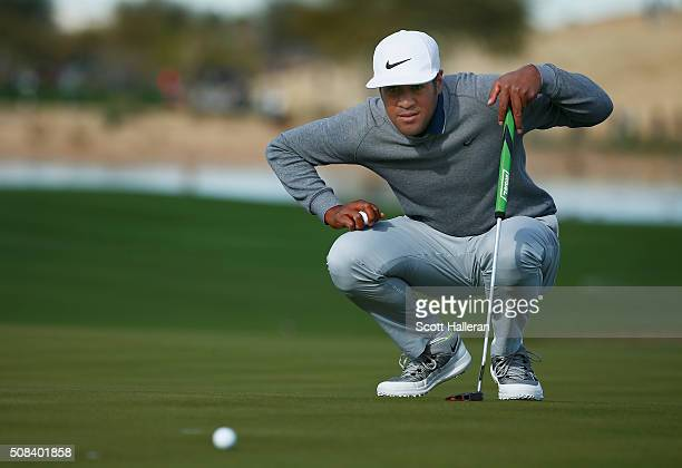 Tony Finau lines up a putt on the 15th hole during the first round of the Waste Management Phoenix Open at TPC Scottsdale on February 4 2016 in...