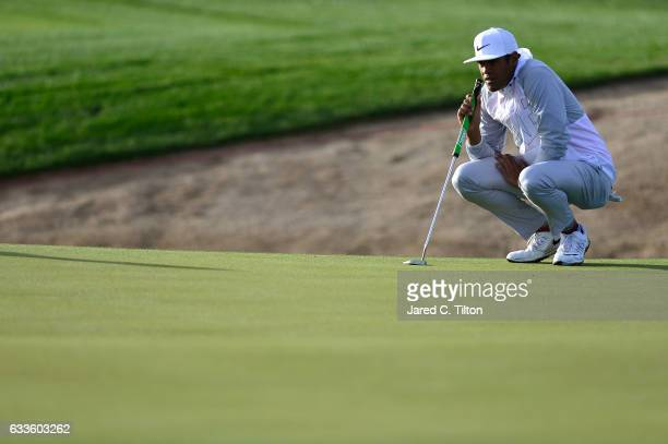 Tony Finau lines up his putt on the third green during the first round of the Waste Management Phoenix Open at TPC Scottsdale on February 2 2017 in...