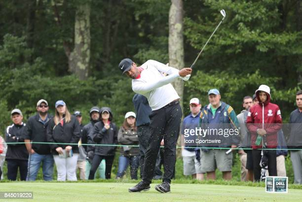 Tony Finau of the United States hits from the 8th tee during the third round of the Dell Technologies Championship on September 3 at TPC Boston in...
