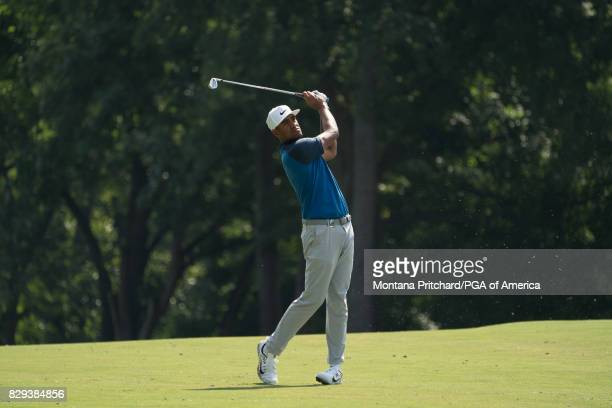 Tony Finau of the United States hits his shot on the 11th hole during Round One for the 99th PGA Championship held at Quail Hollow Club on August 10...