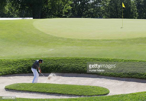 Tony Finau of the United States plays a bunker shot on the 11th hole during the second round of The Barclays at Plainfield Country Club on August 28...