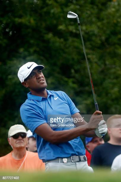 Tony Finau of the United States plays his shot during a practice round prior to the 2017 PGA Championship at Quail Hollow Club on August 8 2017 in...